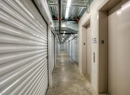 StorQuest Self Storage well lit hallway in Tigard, Oregon