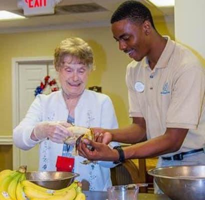 Senior woman with caretaker at The Colonial at Old Camden in Camden, South Carolina