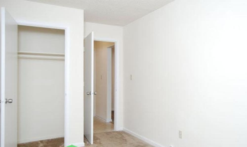 Spacious closet in bedroom of model home at Willow Oaks Apartments in Chesapeake, Virginia