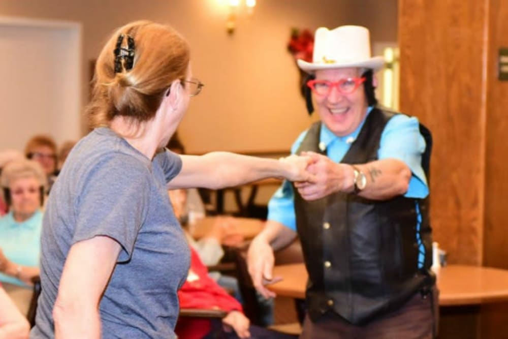 Resident dancing at a community event at River Commons Senior Living in Redding, California
