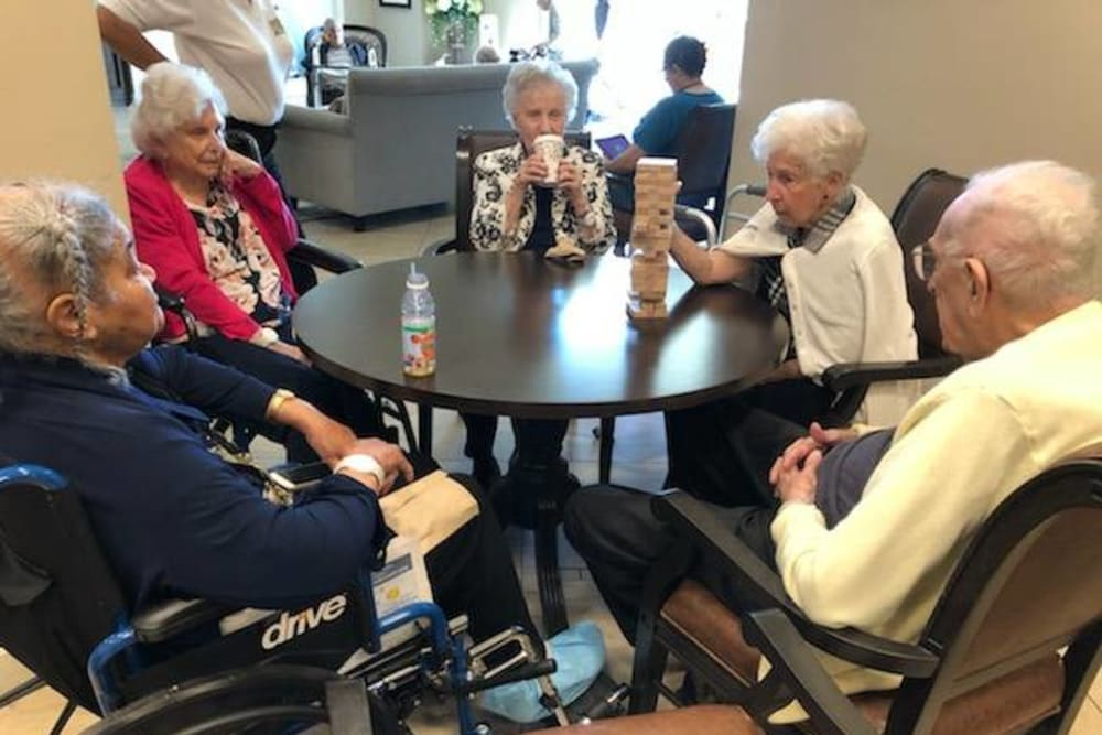 Residents playing Jenga at Inspired Living Kenner in Kenner, Louisiana