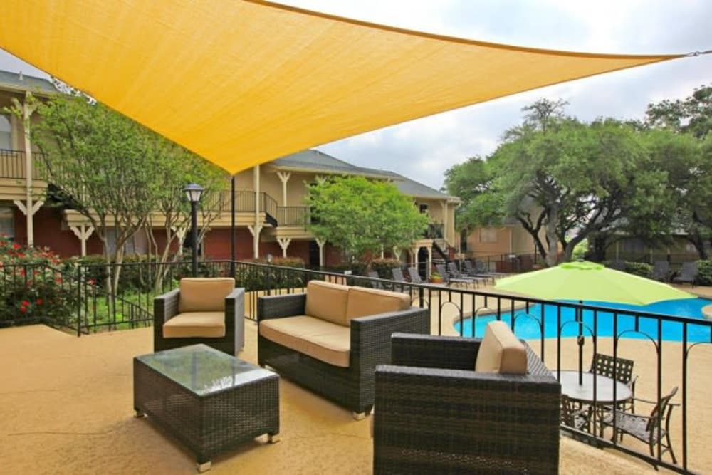 Seating near swimming pool at Bridge at Terracina in Austin, Texas