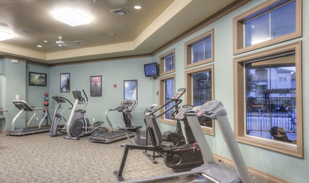 Fully-equipped fitness center at Stone Creek Apartments