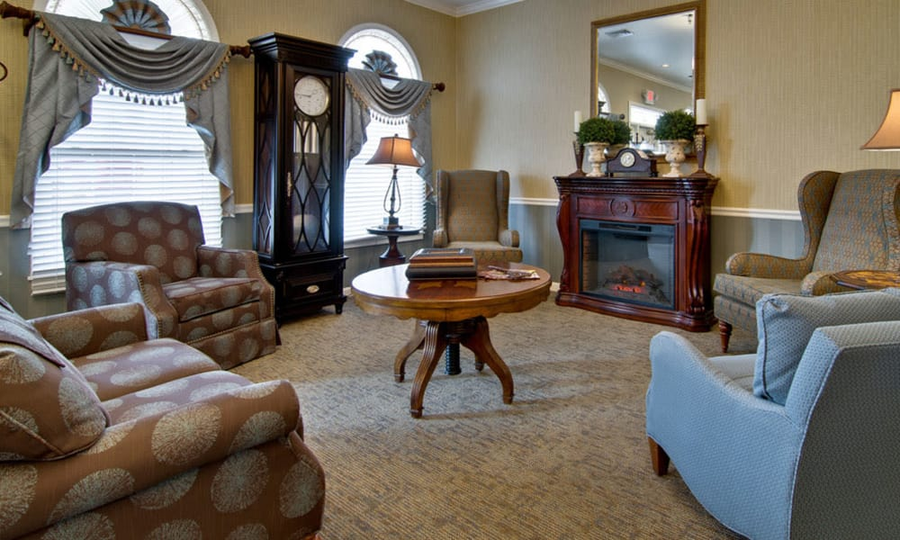 Community lounge with fireside seating at Alexandria Place in Jackson, Tennessee