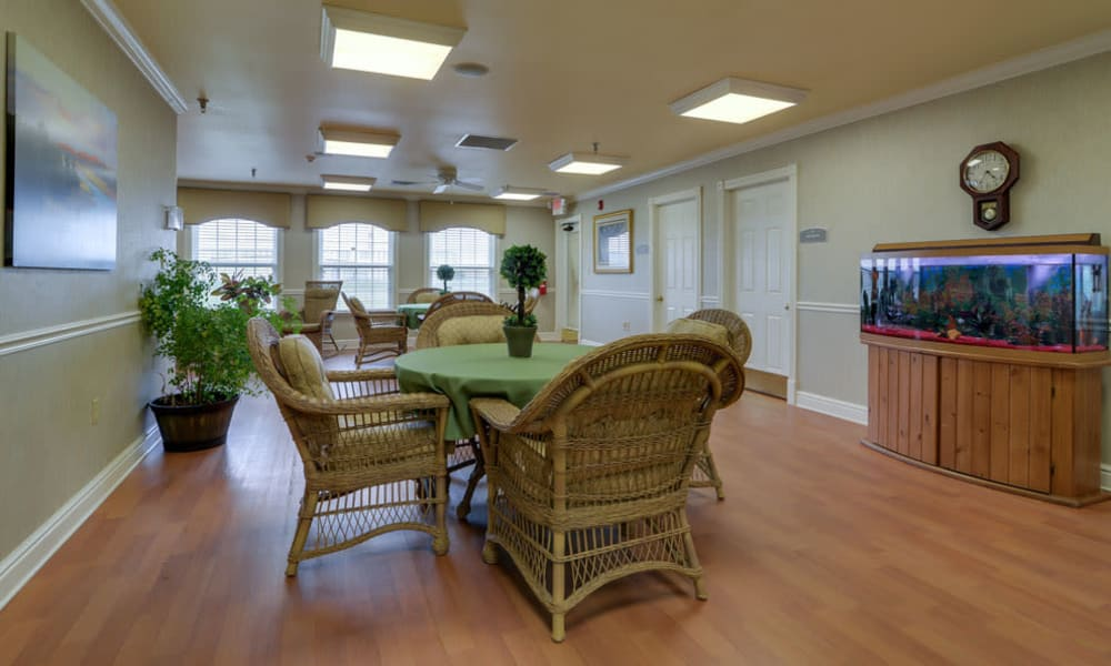 Activity room with comfortable seating at The Arbors at WestRidge Place in Sikeston, Missouri