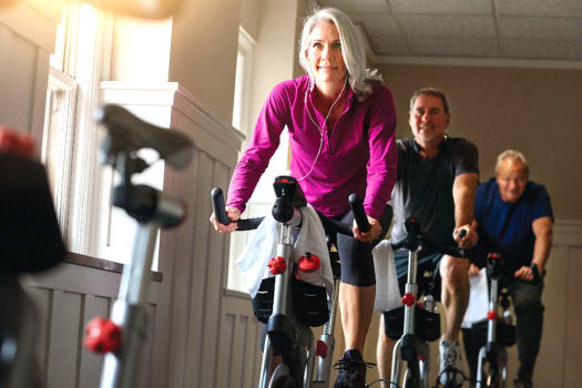Residents in a spin class at The Alexander in Bend, Oregon