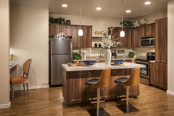 Kitchen with custom cabinetry at San Valencia in Chandler, Arizona