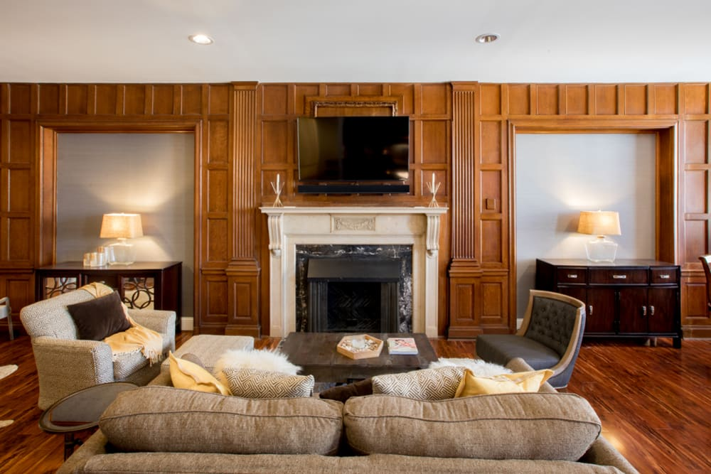 A fireplace is a feature of this well appointed living room at The Reserve at 4th and Race in Cincinnati, Ohio