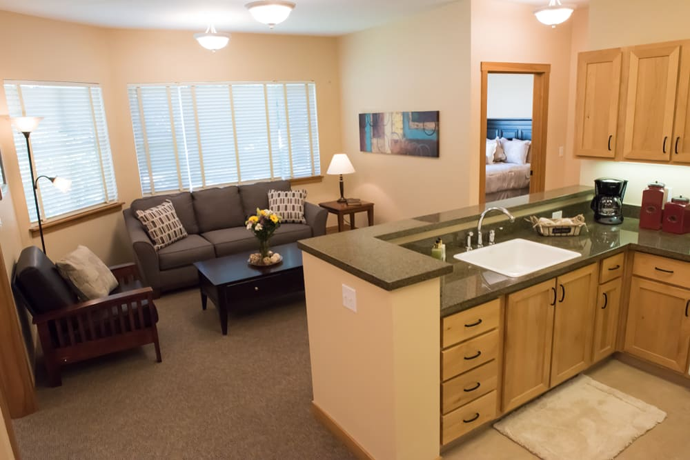 Spacious living area in assisted living apartment at The Springs at Wilsonville in Wilsonville, Oregon