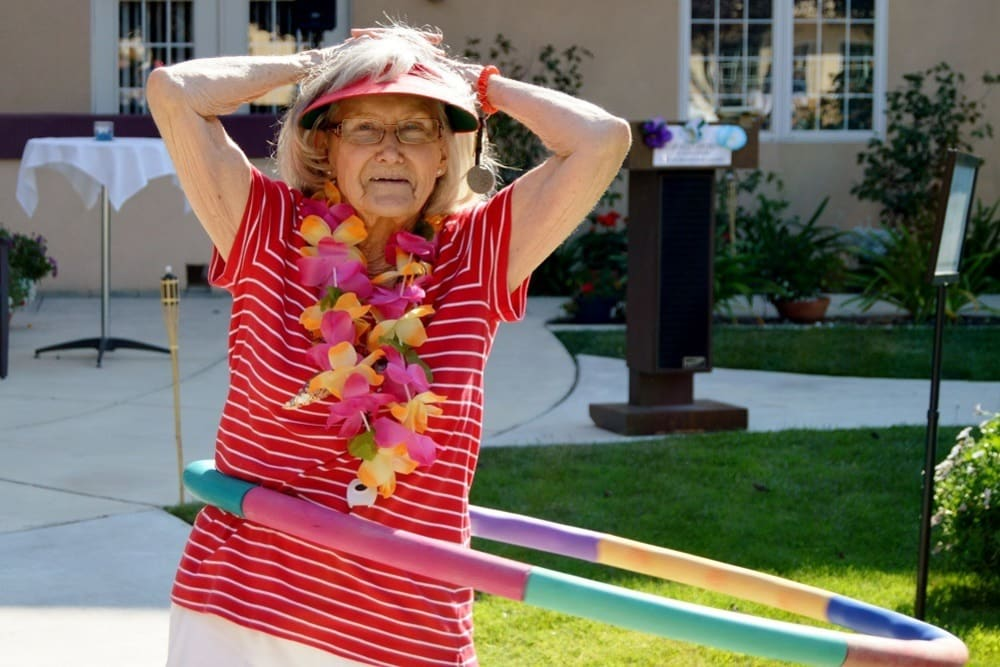 Resident Hula Hooping at Merrill Gardens at Santa Maria in Santa Maria, California