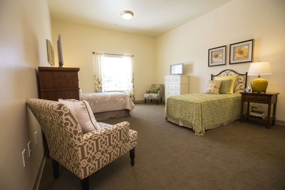 Shared memory care bedroom at The Pointe at Summit Hills in Bakersfield, California.
