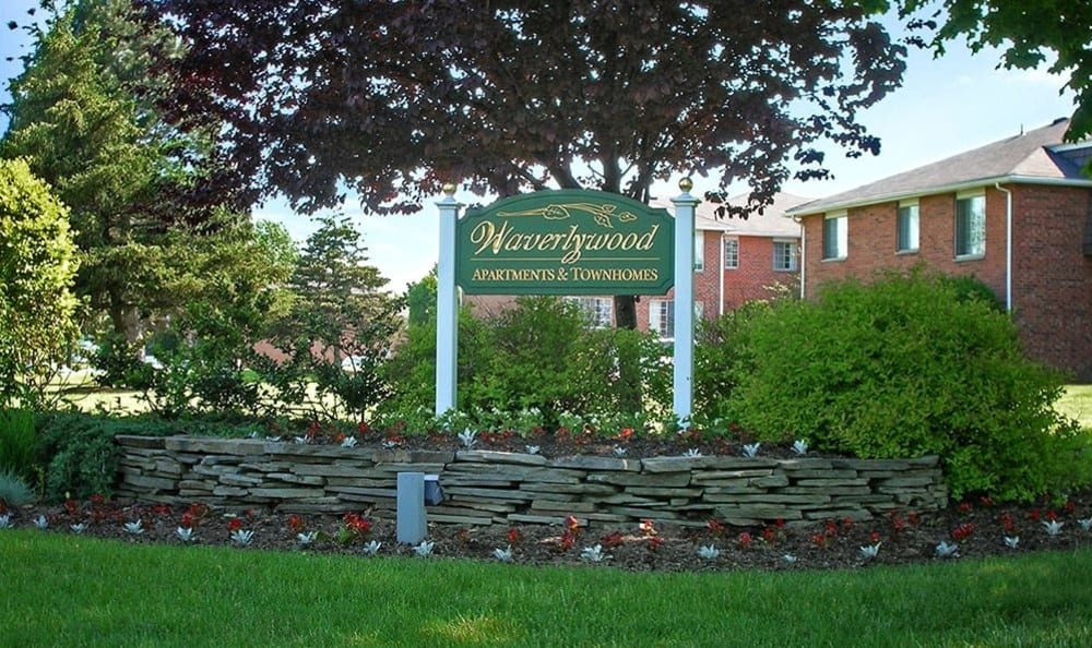 Front sign at Waverlywood Apartments & Townhomes in Webster, New York