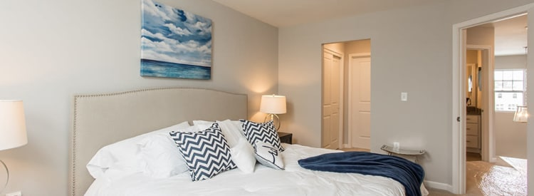Well decorated bedroom at Woodland Acres Townhomes home in Liverpool