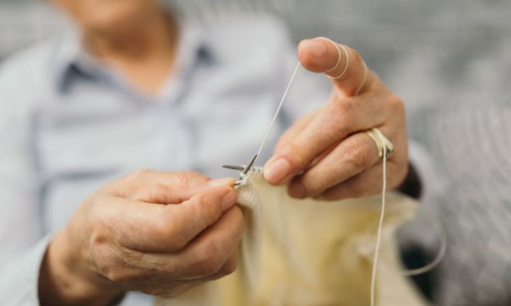 Senior knitting at The Bellettini in Bellevue, Washington