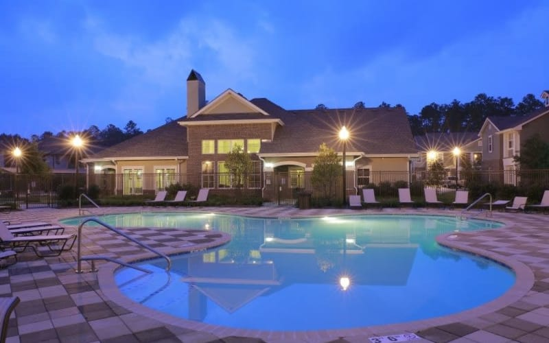 Enjoy a sparkling swimming pool at Palmetto Greens Apartment Homes in Covington, Louisiana