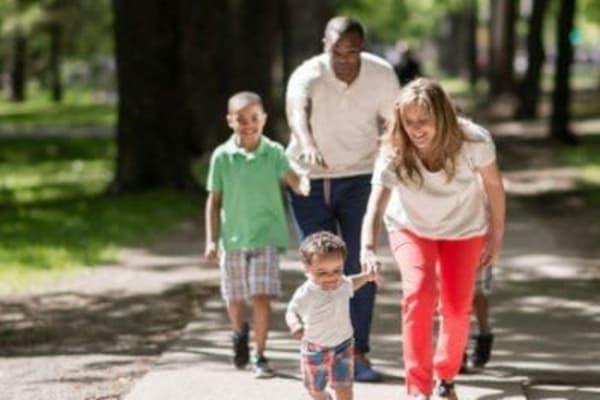 Family walking in Penfield, New York near Penbrooke Meadows