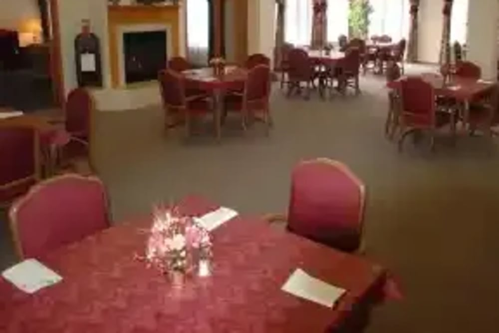 Red dining area at Avalon Assisted Living Community in Fitchburg, Wisconsin