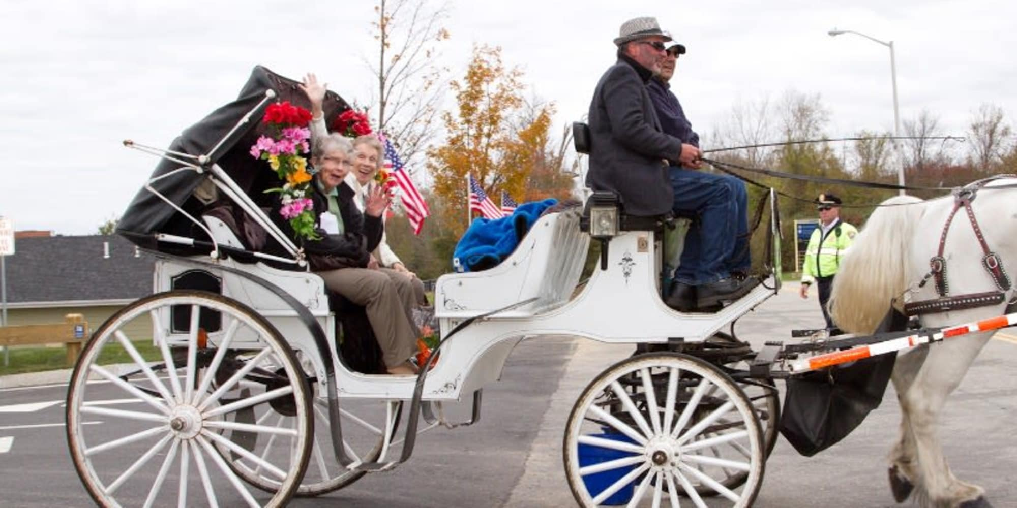 Two residents from Sterling Heights Gracious Retirement Living in Bethlehem, Pennsylvania in a horse drawn carriage