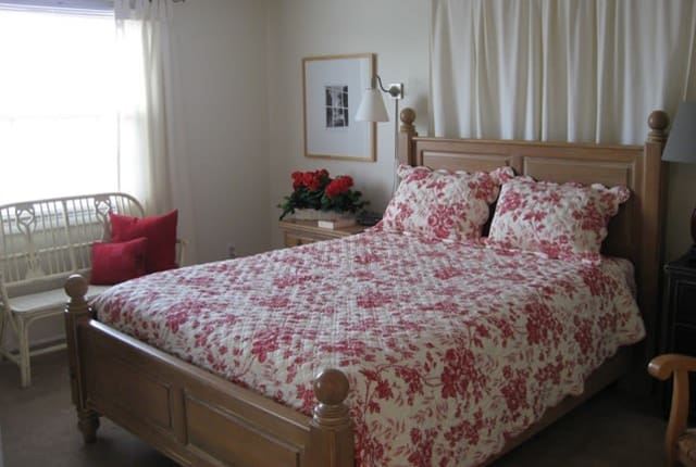 Saddle Club Townhomes offers a naturally well-lit bedroom in Liverpool, NY