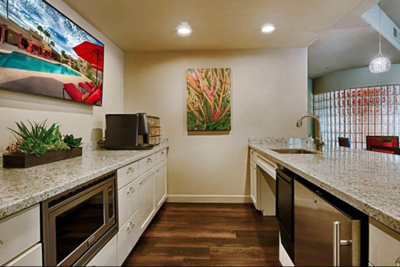 Enjoy access to a clubhouse kitchen at Casa Santa Fe Apartments in Scottsdale, Arizona