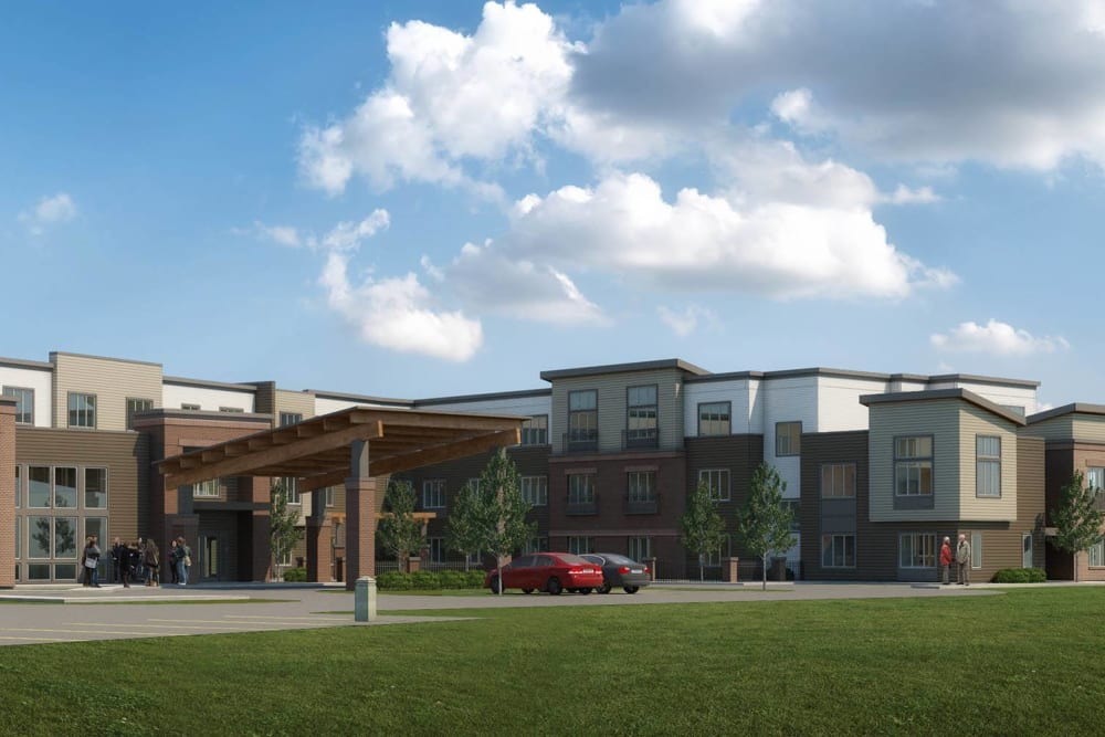 A rendering of the front entrance with cars parked in the front at Brightwater Senior Living of Tuxedo in Winnipeg, Manitoba