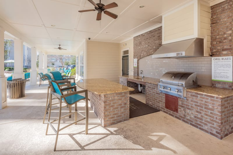 Indoor outdoor clubhouse with grilling and bar seating at Arbor Village in Summerville, South Carolina