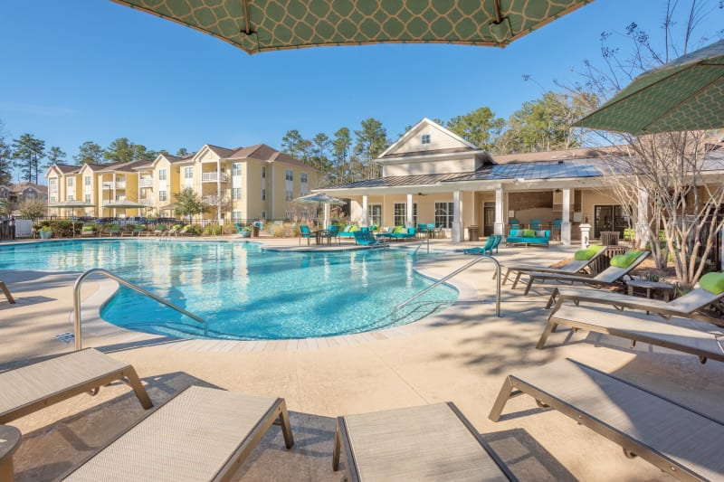 Relax in one of the many lounge chairs next to the resort style pool at Arbor Village in Summerville, South Carolina