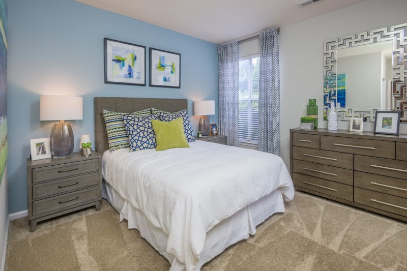 Bedroom with lots of space and a large window for lots of light at The Mark in Raleigh, North Carolina