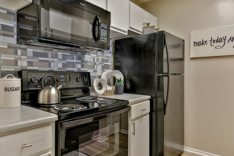 Kitchen with all black appliances at Lyric on Bell in Antioch, Tennessee