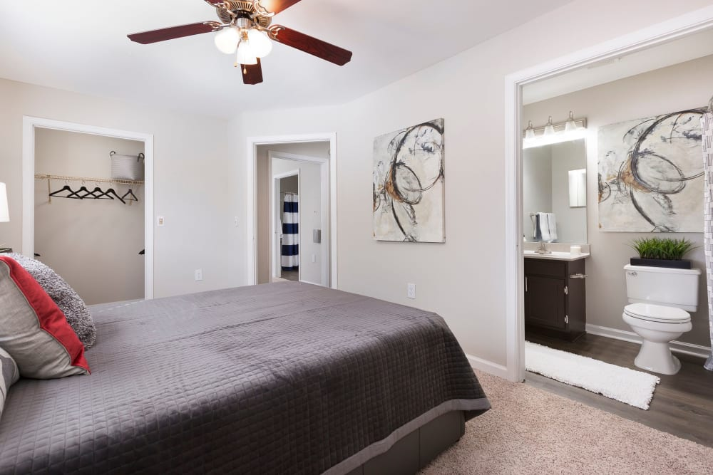 Model bedroom with spacious closet and private bathroom at Ascend @ 1801 in Charlotte, North Carolina