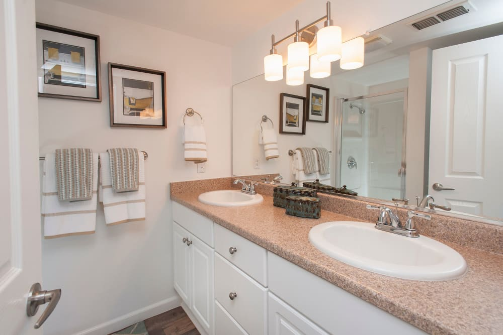 Bathroom with white finishes at Azure Apartment Homes in Petaluma, California