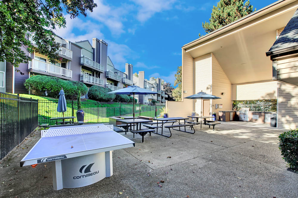 Barbecue area and outdoor ping pong table at Park South Apartments in Seattle, Washington