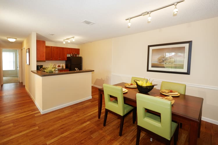 Well-equipped kitchen and beautiful dining area at Middletown Ridge Apartments