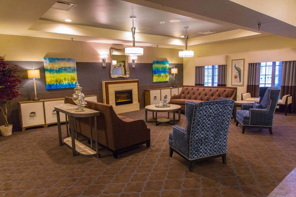 Comfortable, fireside lounge seating at Orchard Grove Health Campus in Romeo, Michigan