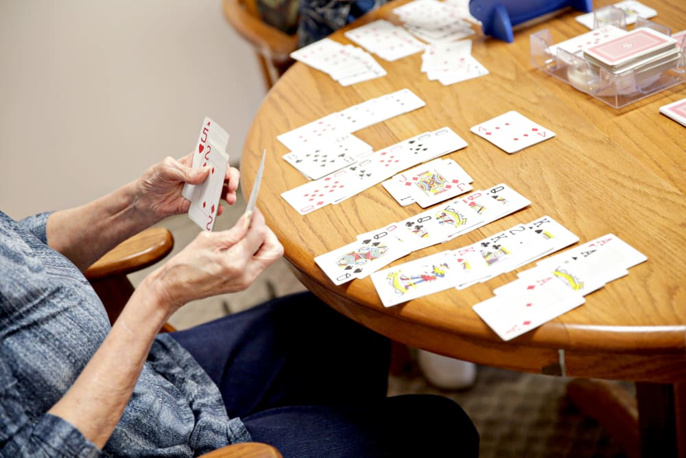 Residents playing cards at Providence Assisted Living in Searcy, Arkansas.