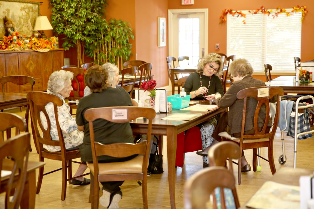 A staff member painting nails at Providence Assisted Living in Senatobia, Mississippi.