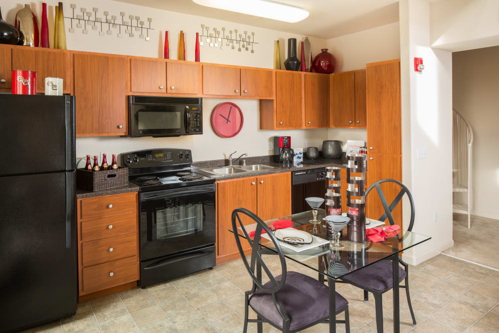 Kitchen and dining room at Venu at Galleria Condominium Rentals in Roseville, California