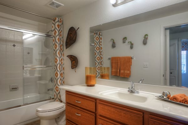 Model bathroom with wooden cabinetry at San Palacio in Chandler, Arizona
