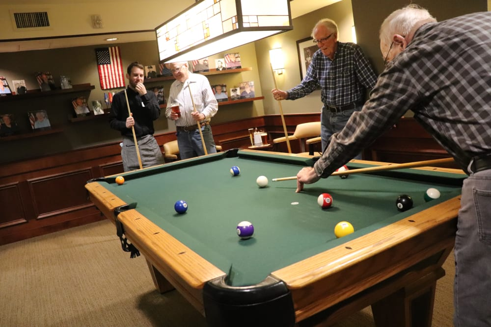 Residents playing pool at The Springs at Carman Oaks in Lake Oswego, Oregon