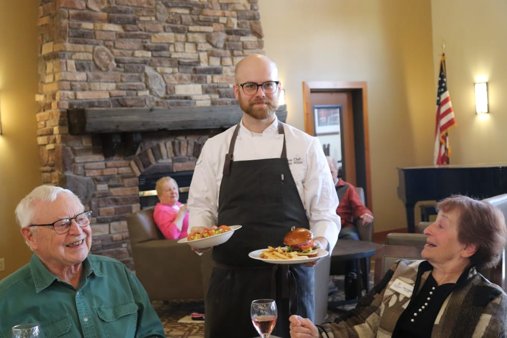 Residents being served dinner in dining room at The Springs at Missoula in Missoula, Montana.