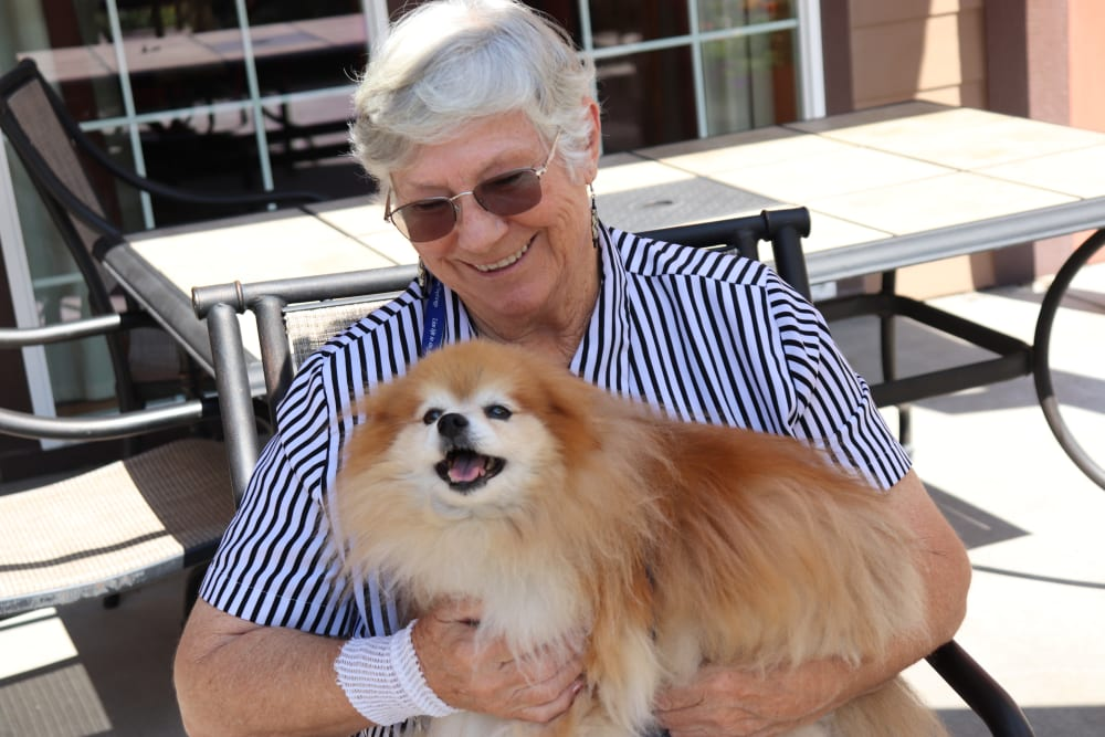 Resident with their cute dog at The Springs at Missoula in Missoula, Montana.