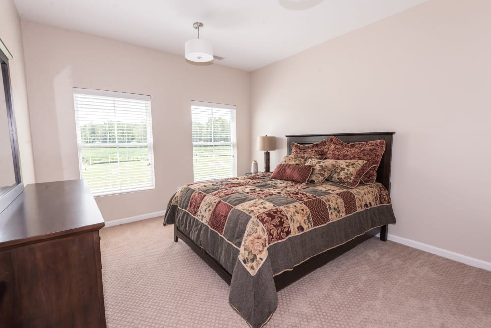 A comfortable apartment bedroom at Legacy Living Florence in Florence, Kentucky