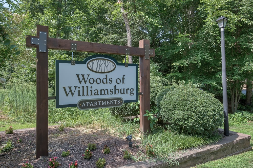 Monument Sign at Woods of Williamsburg Apartments in Williamsburg, Virginia