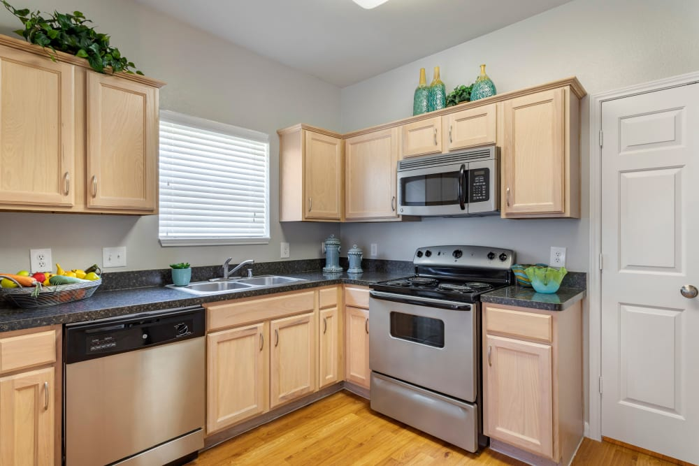 Fully equipped kitchen with stainless steel appliances at Regency at First Colony in Sugar Land, Texas