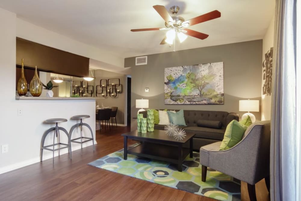 Modern living room with hardwood floors at Circle at Point Park in Houston, Texas
