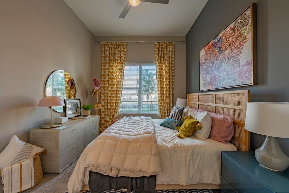 Primary bedroom with a bathroom at Encore Tessera in Phoenix, Arizona
