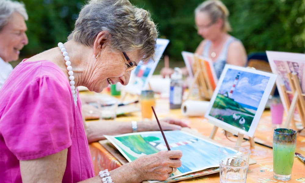 A resident painting at Amaran Senior Living in Albuquerque, New Mexico.