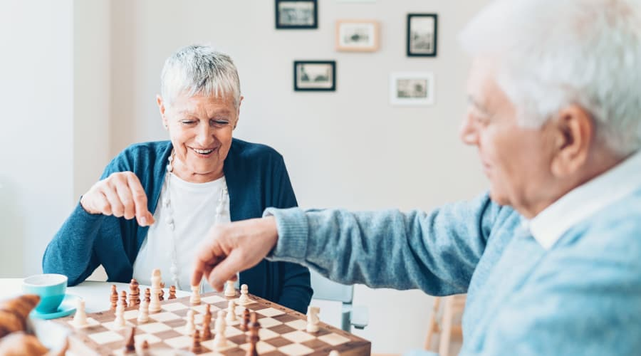 Residents playing chess at Mill Hill Residence in West Yarmouth, Massachusetts