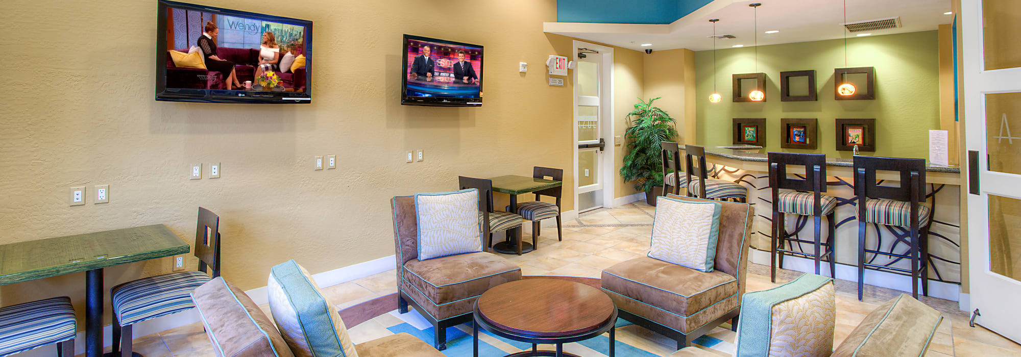 Resident clubhouse with TVs at Azul at Spectrum in Gilbert, Arizona