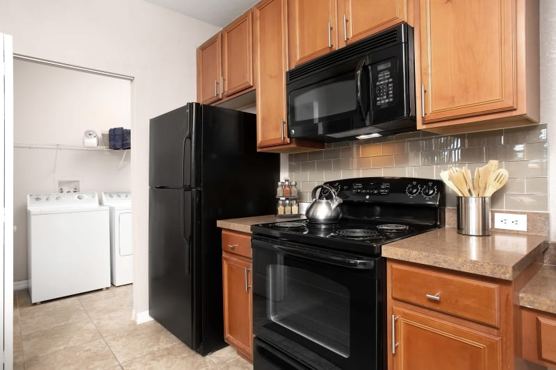 Kitchen with adjacent Washer and Dryer room at The Aspect in Kissimmee, Florida